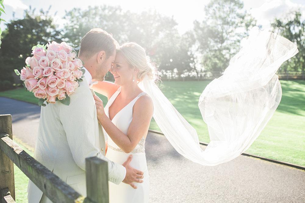 Bride with blush pink bouquet at Mythe Barn Wedding Venue Warwickshire