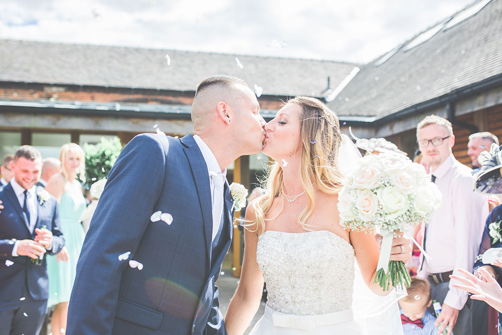 Confetti Shot Kiss at Mythe Barn Wedding Venue