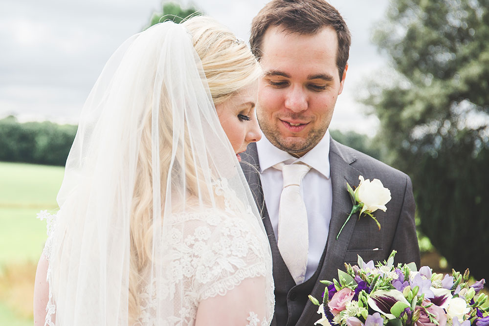 Bride with Purple and Lilac Bouquet at Prestwold Hall Wedding, Loughborough, UK
