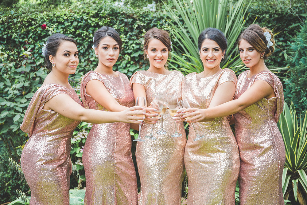 Bridesmaids in Rose Gold Sequin Bridesmaid Dresses. Greek Wedding at Alrewas Hayes