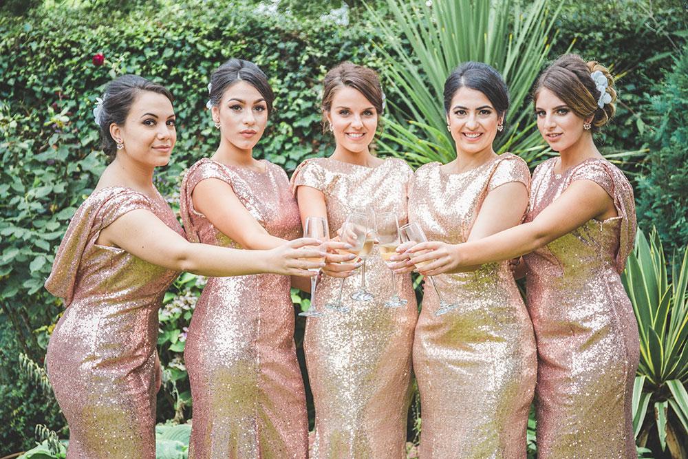 Bridesmaids in Rose Gold Sequin Bridesmaid Dresses. Greek Wedding at Alrewas Hayes