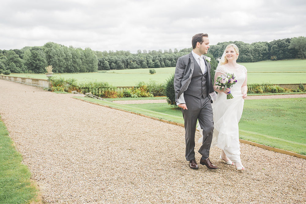Natural moment between Bride and Groom at Prestwold Hall Wedding, Loughborough