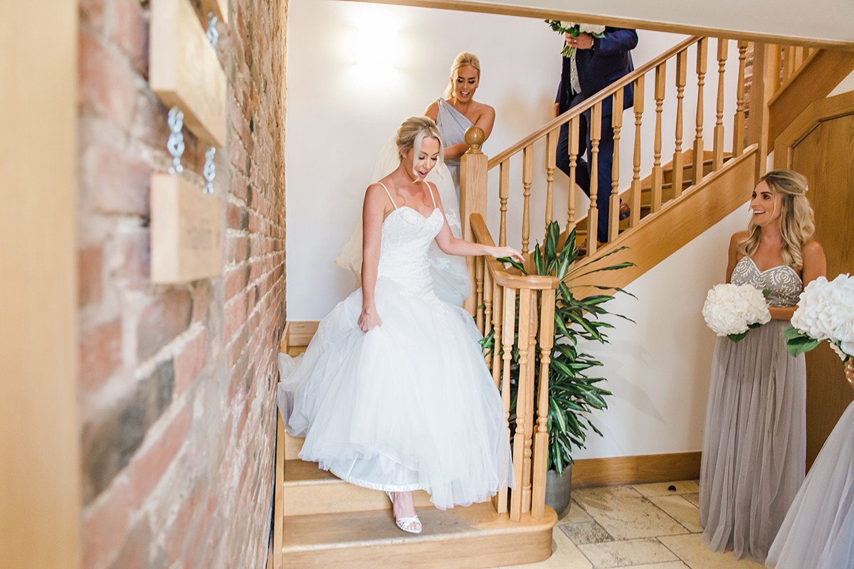 First Look at Bride in her Wedding Dress Before her Mythe Barn Wedding