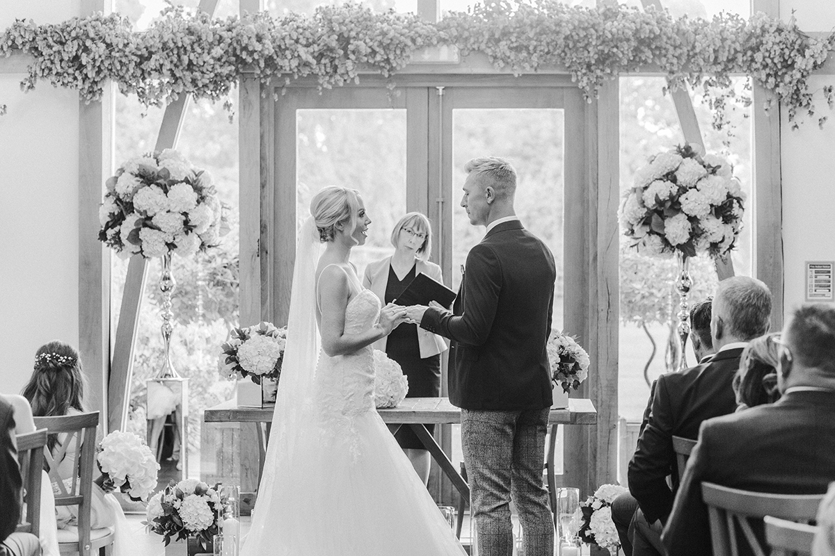 Bride and Groom Vows during Mythe Barn Wedding in Warwick