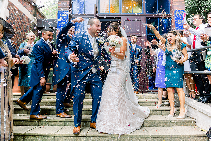 5 wedding planning tips image of newlyweds showered with confetti